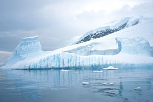 Vertical melt lines may form while the iceberg is underwater as bubbles are released while the ice melts.