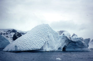 The pockets on this iceberg were formed when this side of the berg was underwater.